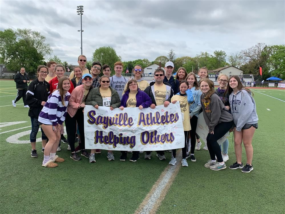 Athletes Helping Others with Special Olympians