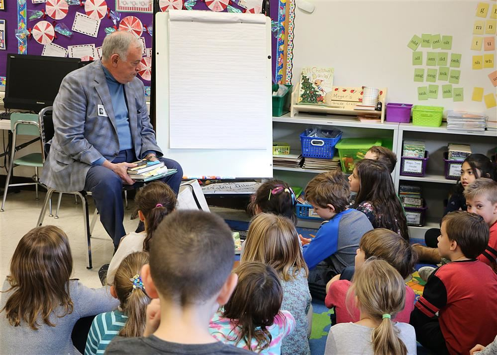 Roger Tilles reads to second graders